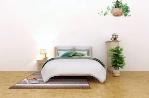 Bedroom decorated with plants.