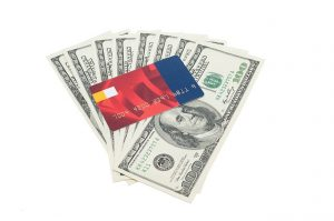 Money, dollar bills, credit card.