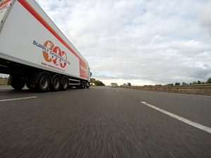 A moving truck on the road.